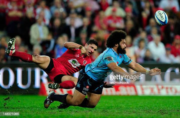 Anthony Fainga'a of the Reds contests the ball with Tatafu PolotaNau of the Waratahs during the round 18 Super Rugby match between the Queensland...