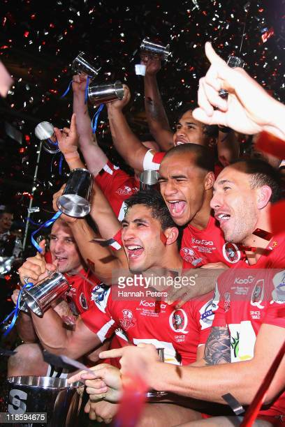Anthony Faingaa Will Genia and Quade Cooper of the Reds celebrate winning the 2011 Super Rugby Grand Final match between the Reds and the Crusaders...
