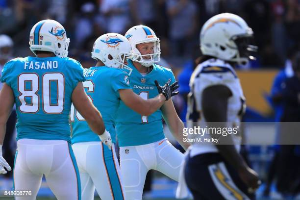 Anthony Fasano and Matt Haack congratulate Cody Parkey of the Miami Dolphins after his 54 yard fieldgoal as Melvin Ingram of the Los Angeles Chargers...