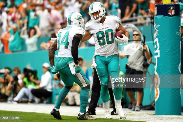 Anthony Fasano of the Miami Dolphins celebrates his touchdown with Jarvis Landry during the second quarter against the New York Jets at Hard Rock...