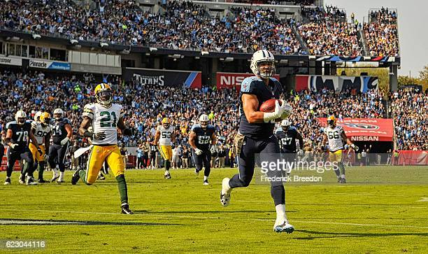 Anthony Fasano of the Tennessee Titans against of the Green Bay Packers scores a touchdown against Ha Ha ClintonDix of the Green Bay Packers during...