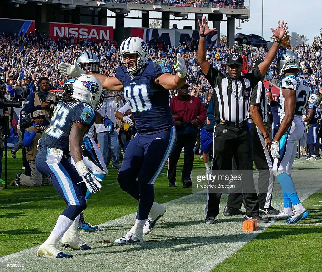 Anthony Fasano #80 of the Tennessee Titans congratulates teammate Dexter McCluster #22 on scoring a touchdown against the Carolina Panthers during the first half at Nissan Stadium on November 15, 2015 in Nashville, Tennessee.