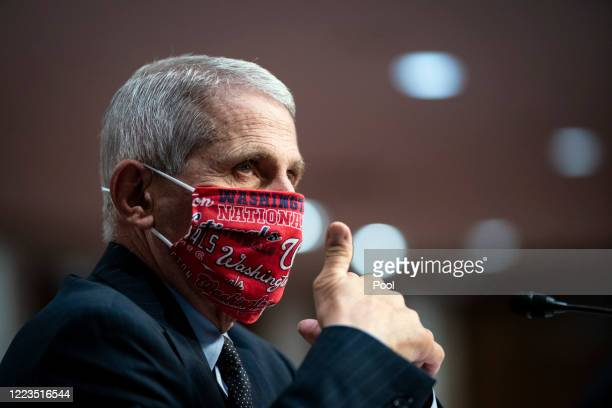 Anthony Fauci, director of the National Institute of Allergy and Infectious Diseases, gives a thumbs up during a Senate Health, Education, Labor and...