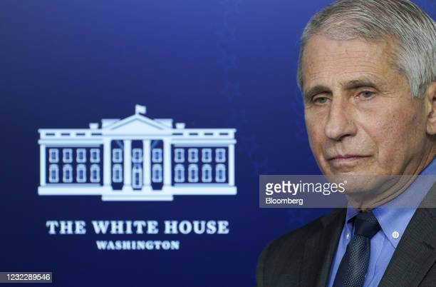 Anthony Fauci, director of the National Institute of Allergy and Infectious Diseases, listens during a news conference in the James S. Brady Press...