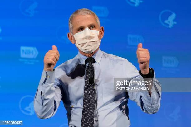 Anthony Fauci, director of the National Institute of Allergy and Infectious Diseases, gestures after receiving his first dose of the Covid-19 vaccine...