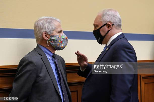 Anthony Fauci, director of the National Institute of Allergy and Infectious Diseases, left, speaks with House Minority Whip Steve Scalise, a...