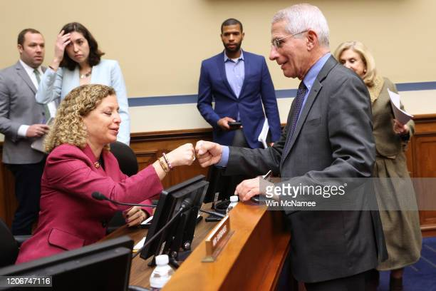Anthony Fauci director of the NIH National Institute of Allergy and Infectious Diseases fist bumps Rep Debbie Wasserman Schultz during a House...