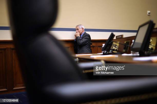 Anthony Fauci director of the NIH National Institute of Allergy and Infectious Diseases takes a private phone call before the start of a House...