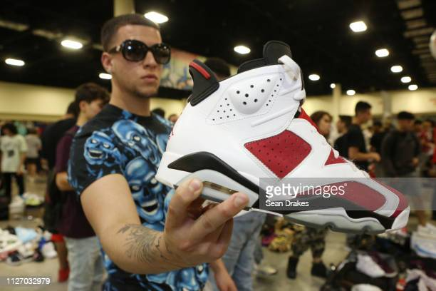 Anthony Fernandez of Miami displays a sneaker from his collection valued at $150 during SneakerCon 2019 at Fort Lauderdale Convention Center on...