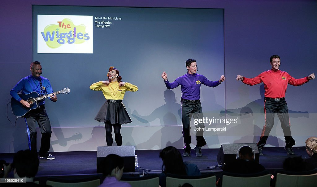 Anthony Field , Emma Watkins, Lachlan Gillespie and Simon Pryce of the Wiggles perform at the Apple Store Soho on May 12, 2013 in New York City.