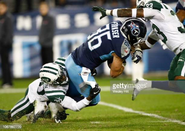 Anthony Firkser of the Tennessee Titans is tackled by Rashard Robinson of the New York Jets while running with the ball during the fourth quarter at...