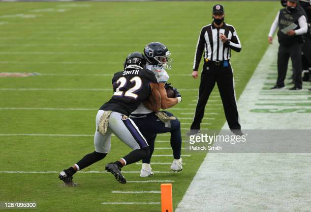 Anthony Firkser of the Tennessee Titans runs against Jimmy Smith of the Baltimore Ravens during the game at M&T Bank Stadium on November 22, 2020 in...