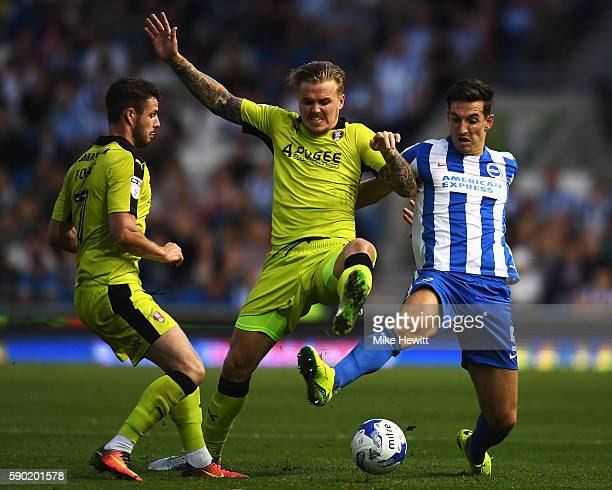Anthony Forde of Rotherham United and Danny Ward of Rotherham United tackle Lewis Dunk of Brighton and Hove Albion during the Sky Bet Championship...