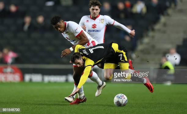 Anthony Forde of Rotherham United clashes with Chuks Aneke of Milton Keynes Dons during the Sky Bet League One match between Milton Keynes Dons and...