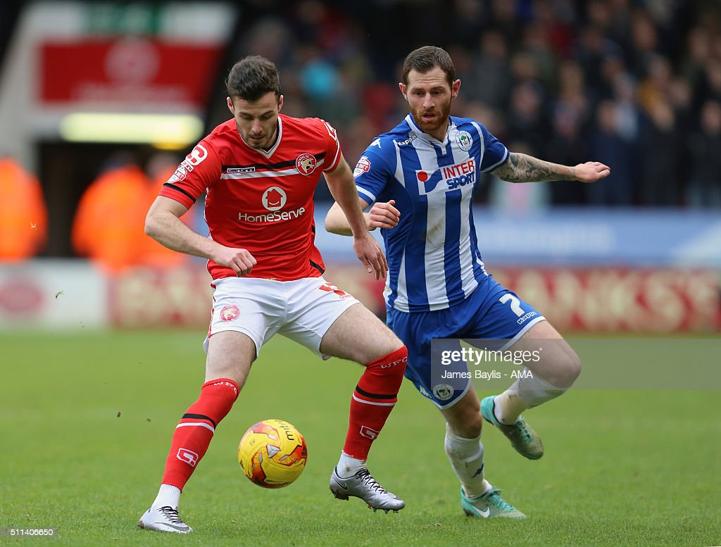 Anthony Forde of Walsall and Chris McCann of Wigan Athletic during the Sky Bet League One match between Walsall and Wigan Athletic at Bescot Stadium on February 20, 2016 in Walsall, England.