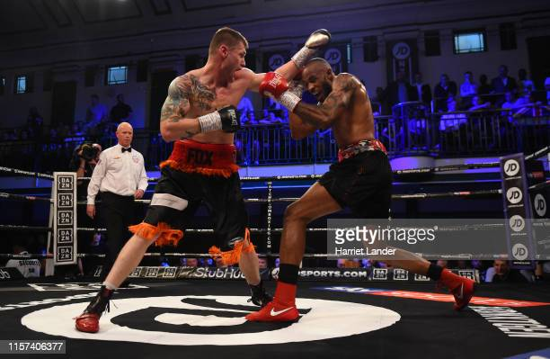Anthony Fox punches Duane Sinclair during the LightHeavyweight fight between Duane Sinclair and Anthony Fox at York Hall on June 21 2019 in London...