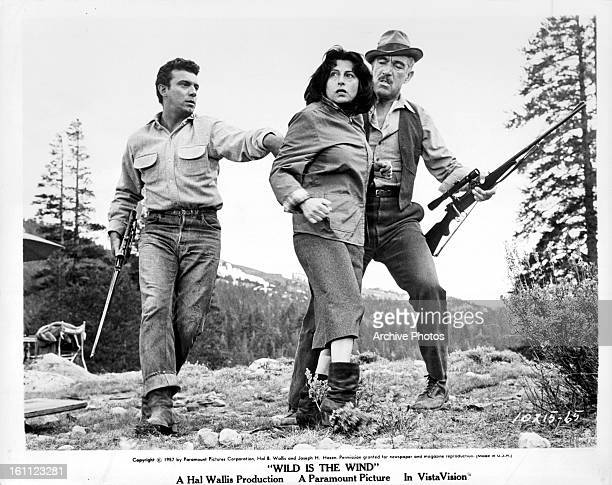 Anthony Franciosa pushes Anna Magnani with Anthony Quinn in a scene from the film 'Wild Is The Wind' 1957