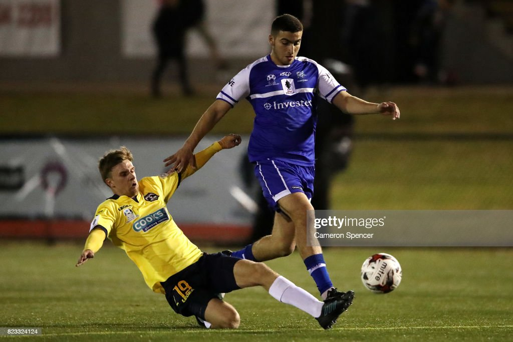 Anthony Frangie of Hakoah FC is tackled by Glen Kelshaw of Hills Brumbies during the FFA Cup round of 32 match between Hills United FC and Hakoah Sydney City East at Lily's Football Stadium on July 26, 2017 in Sydney, Australia.
