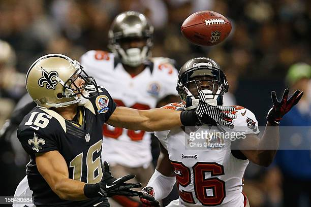 Anthony Gaitor of the Tampa Bay Buccaneers breaks up a pass intended for Lance Moore of the New Orleans Saints at the MercedesBenz Superdome on...