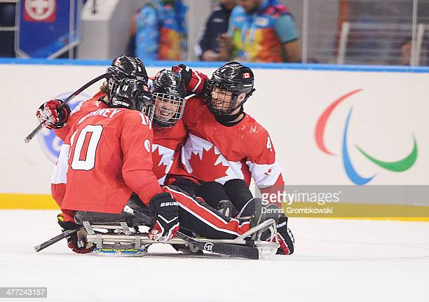 Anthony Gale of Canada celebrates with team mates after scoring a goal during the Preliminary Round Group A match between Canada and Sweden at Shayba...