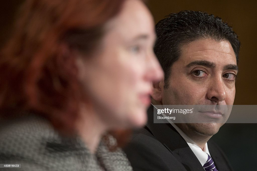 Anthony Gallippi, co-founder and chief executive officer of BitPay Inc., right, looks on as Mercedes Kelley Tunstall, partner with Ballard Spahr LLP, speaks during a Senate Banking Subcommittee hearing on virtual currency in Washington, D.C., U.S., on Tuesday, Nov. 19, 2013. Bitcoin's rally is accelerating as the U.S. Department of Justice's description of the digital currency as a 'legal means of exchange' bolsters the prospect of wider acceptance as an alternative payment system. Photographer: Andrew Harrer/Bloomberg via Getty Images