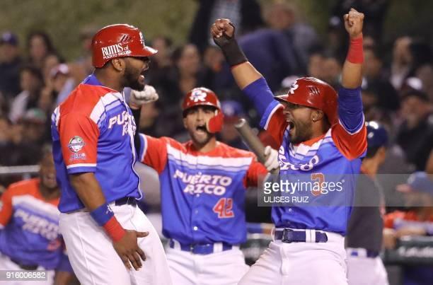 Anthony Garcia and teammate Jesmuel Valentinof Criollos de Caguas from Puerto Rico celebrate their victory against Aguilas Cibaenas of Republica...