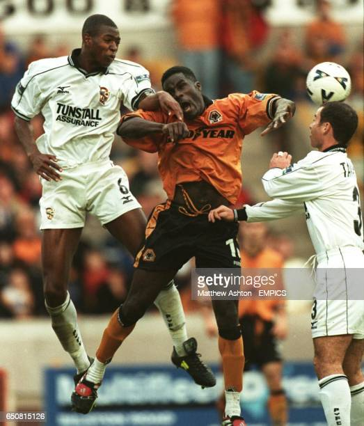 Anthony Gardner of Port Vale battles for the ball with Ade Akinbiyi of Wolverhampton Wanderers and Vale's Allen Tankard moving in on the right