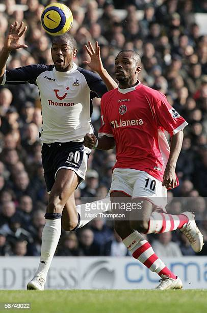 Anthony Gardner of Tottenham Hotspur tussles for posession with Darren Bent of Charlton Athletic during the Barclays Premiership match between...