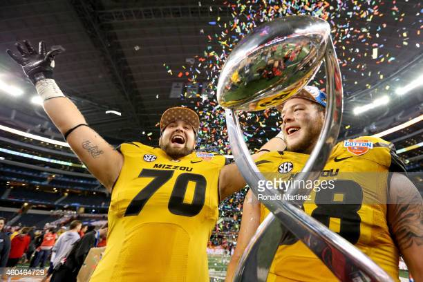 Anthony Gatti and Justin Britt of the Missouri Tigers celebrate after the Tigers defeat the Oklahoma State Cowboys 41-31 during the AT&T Cotton Bowl...