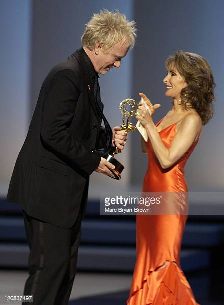 Anthony Geary accepts the award for Outstanding Lead Actor in a Drama Series for his role in 'General Hospital' from presenter Susan Lucci