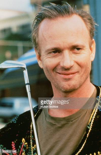 Anthony Geary holds a golf club in a scene from the movie 'You Can't Hurry Love' circa 1988