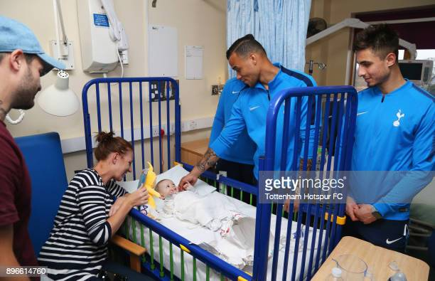 Anthony Georgiou and Michel Vorm meet a young patient during a Tottenham Hotspur player visit at Princess Alexandra Hospital on December 21 2017 in...