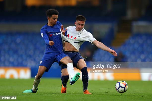 Anthony Georgiou of Tottenham Hotspur gets his shirt tugged by Jacob Maddox of Chelsea during the Premier League 2 match between Chelsea and...