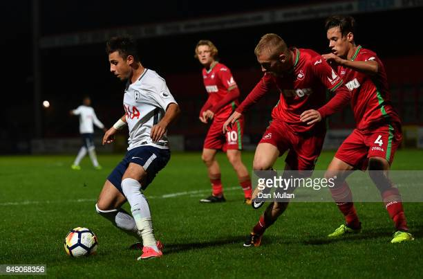 Anthony Georgiou of Tottenham Hotspur holds off Ollie McBurnie and Jack Evans of Swansea City during the Premier League 2 match between Tottenham...
