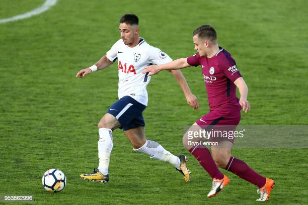Anthony Georgiou of Tottenham Hotspur is tackled by Luke Bolton of Manchester City during the Premier League 2 match between Tottenham Hotspur and...