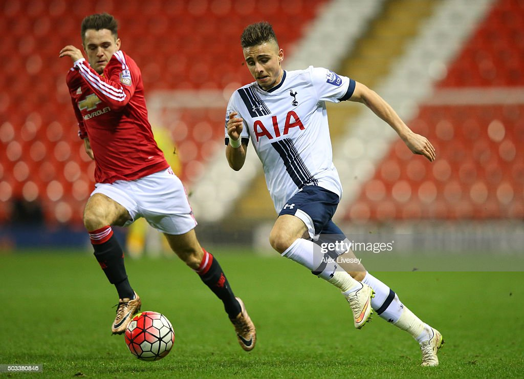 Anthony Georgiou of Tottenham Hotspur U21 takes on Joe Riley of Manchester United U21 during the Barclays U21 Premier League match between Manchester United U21 and Tottenham Hotspur U21 at Leigh Sports Village on January 4, 2016 in Leigh, Greater Manchester.