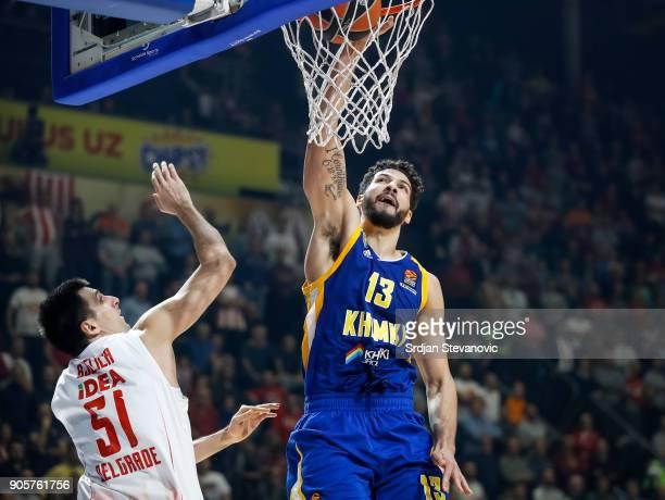 Anthony Gill of Khimki scores near Milko Bjelica of Crvena Zvezda during the 2017/2018 Turkish Airlines EuroLeague Regular Season Round 18 game...