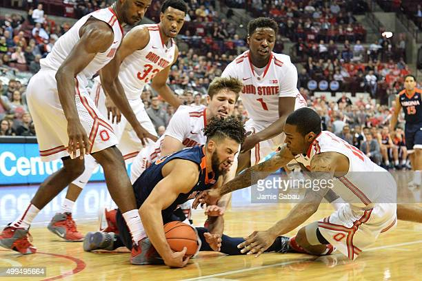 Anthony Gill of the Virginia Cavaliers battles all five Ohio State Buckeyes for control of a loose ball in the first half on December 1 2015 at Value...