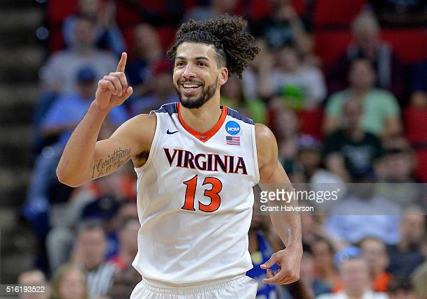 Anthony Gill of the Virginia Cavaliers celebrates in the second half against the Hampton Pirates in the first round of the 2016 NCAA Men's Basketball...