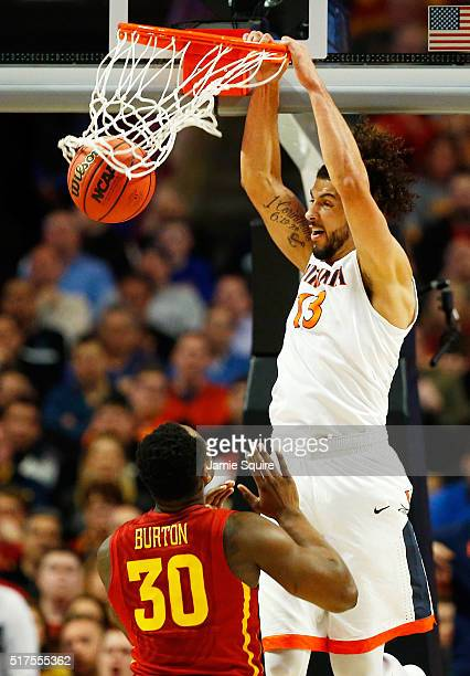 Anthony Gill of the Virginia Cavaliers dunks against Deonte Burton of the Iowa State Cyclones in the second half during the 2016 NCAA Men's...