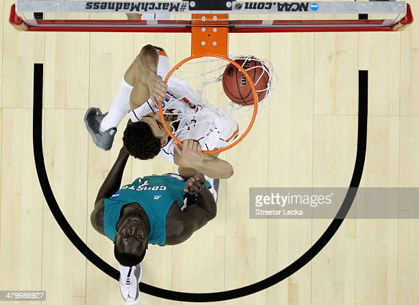 Anthony Gill of the Virginia Cavaliers dunks against El Hadji Ndieguene of the Coastal Carolina Chanticleers during the Second Round of the 2014 NCAA...