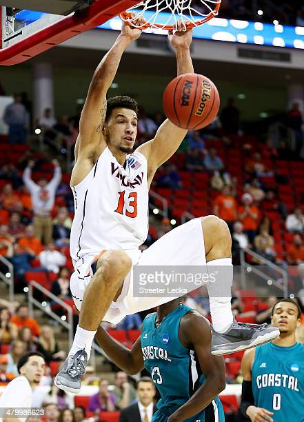 Anthony Gill of the Virginia Cavaliers dunks against the Coastal Carolina Chanticleers in the second half during the Second Round of the 2014 NCAA...