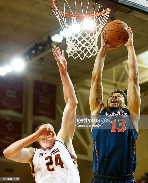 Anthony Gill of the Virginia Cavaliers dunks the ball in front of Dennis Clifford of the Boston College Eagles in the first half during the game at...