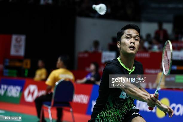 Anthony Ginting of Indonesia competes in the Men's Singles quarter final match against Huang Yu Xiang of China on day four of the Daihatsu Indonesia...