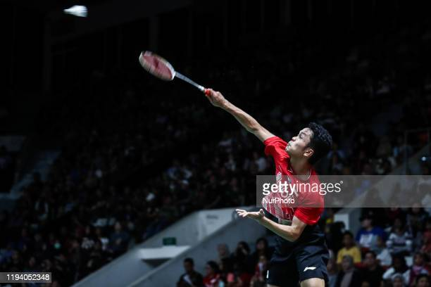 Anthony Ginting of Indonesia competes in the Men's Singles second-round match against Tommy Sugiarto of Indonesia on day three of the Daihatsu...