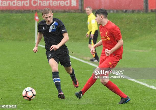 Anthony Glennon of Liverpool and Alex Curran of Blackburn Rovers in action during the Liverpool v Blackburn Rovers U18 Premier League game at The...