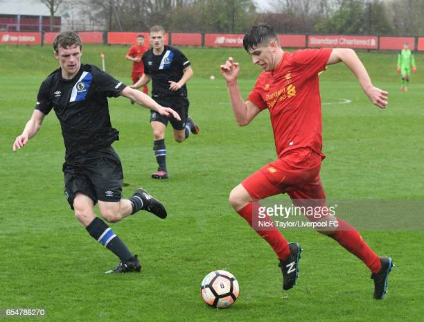 Anthony Glennon of Liverpool and Andrew Jackson of Blackburn Rovers in action during the Liverpool v Blackburn Rovers U18 Premier League game at The...