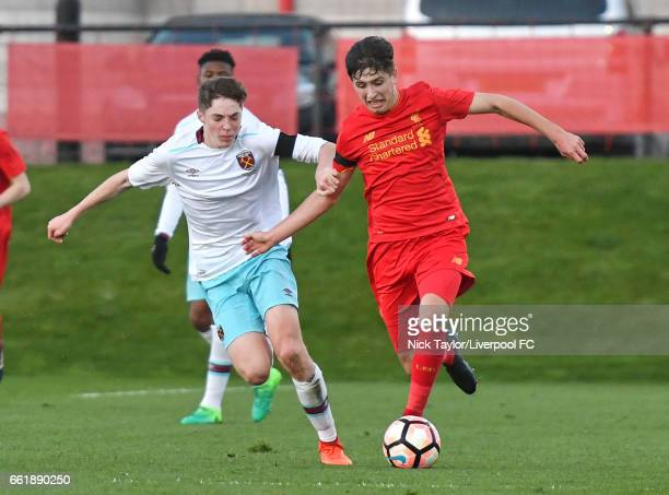 Anthony Glennon of Liverpool and Conor Coventry of West Ham United in action during the Liverpool v West Ham United U18 Premier League game at The...