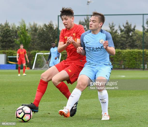 Anthony Glennon of Liverpool and Luke Bolton of Manchester City in action during the Manchester City v Liverpool U18 Premier League game at Etihad...