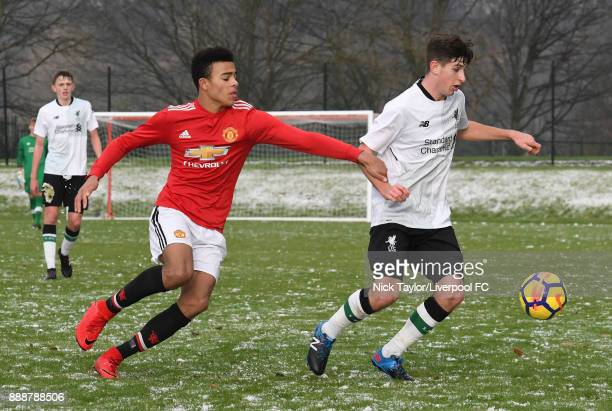 Anthony Glennon of Liverpool and Mason Greenwood of Manchester United in action during the Manchester United v Liverpool U18 Premier League game at...